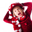 Little girl wearing red dress and funny red and white hat — Stock Photo #5222807