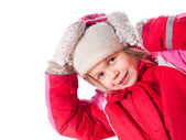 The laughing girl wearing red overalls and mittens with snow — Stock Photo