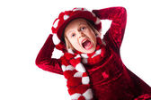 Little girl wearing red dress and funny red and white hat — Stock Photo
