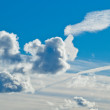 Stock Photo: White fluffy clouds in blue sky