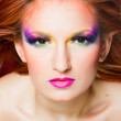 Close up of face with multicolored make-up — Stock Photo