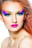 Portrait of woman with multicolored make-up and long red hair — Stock Photo