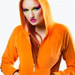 Girl  wearing orange jacket with hood — Stok fotoğraf