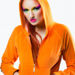 Girl  wearing orange jacket with hood — Stock fotografie