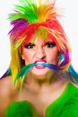 Beautiful woman with vibrant make-up wearing multicolored wig and green dre — Foto Stock