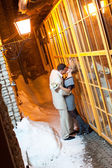 Just married couple outdoors in winter kissing — Stock Photo