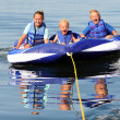 3 Kids on Water Tube — Stock Photo