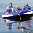 Stock Photo: 3 Kids on Water Tube