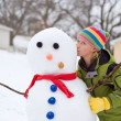 Cute Young Girl Kisses Snowman — Stock Photo