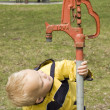 Stock Photo: Little Boy and Water Pump