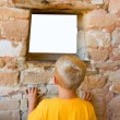 Boy Looks Through Window — Stock Photo