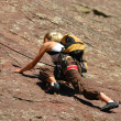 Stock Photo: Female Rock Climber Reaches for Hold