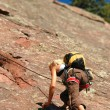 Stock Photo: Female Rock Climber Ascending