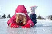 Young Girl Prone on Frozen Lake — Stock Photo