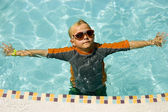 Boy Goggles Floating Near Edge of Pool — Stock Photo