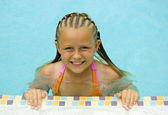 Young Girl Smiles at Poolside — Stock Photo