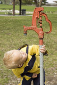 Little Boy and Water Pump — Stock Photo