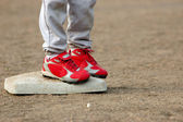 Red Cleats on Base — Stock Photo