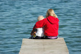 Sister and Brother Sitting on Dock — Stock Photo