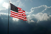 American Flag Against Stormy Skies — Stock Photo