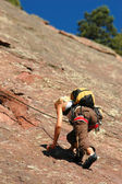 Female Rock Climber Ascending — Stock Photo