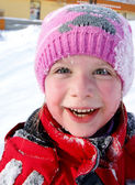 Happy little girl in the snow — Stock Photo