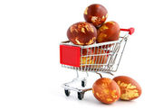 Easter eggs in shopping trolley — Stock Photo