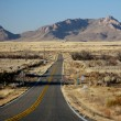 Stock Photo: Road throught desert