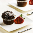 Stock Photo: Chocolate Muffins with Strawberries