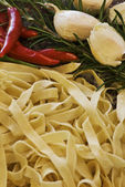 Fresh pasta with ingrediants — Stock Photo