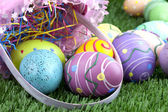 Easter basket and colorful eggs — Stock Photo