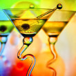 Martini glasses in front of colorful background — Stock Photo #5270823