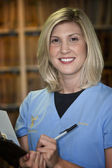 Beautiful blonde medical assistant — Stock Photo