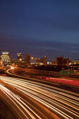 Atlanta twilight skyline showing traffic streaks — Stock Photo