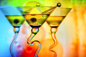 Martini glasses in front of colorful background — Stock Photo