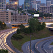 Atlanta twilight skyline showing traffic streaks — Stock Photo