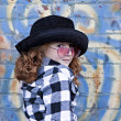 Red haired little girl in front of brick wall — Stock Photo