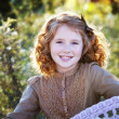 Little redheaded girl outdoors — Stock Photo