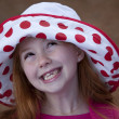 Cute little redhead in hat outdoors — Stock Photo #5326757