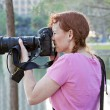Red haired photographer with pigtails — Stock Photo