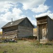 Abandoned House and Outhouse in Colorado Ghost Town - Stock Photo