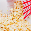 Royalty-Free Stock Photo: Popcorn falling out of a holder