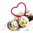 Chocolate Cupcakes with White Frosting sprinkles and heart — Stock Photo