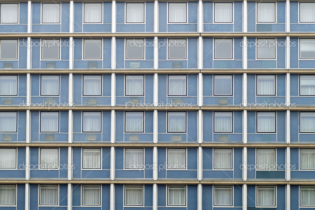 Symmetrical facade windows full of the same  Stock Photo #5334124