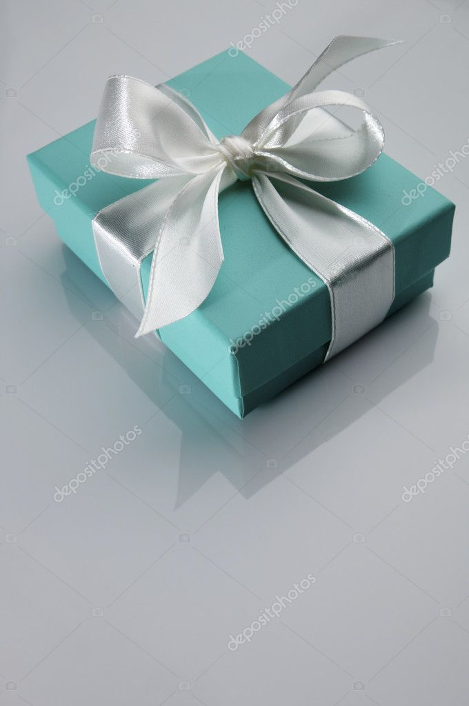 Small turquoise box tied with a white ribbon — Stock Photo #5347506