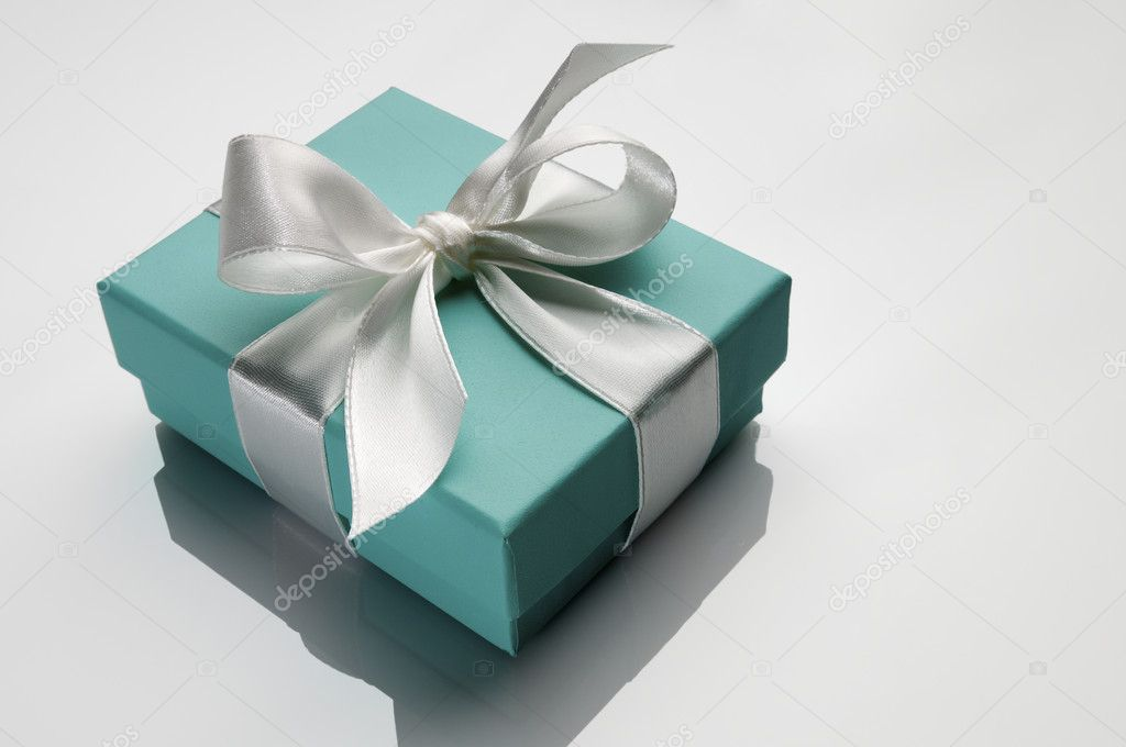 Small turquoise box tied with a white ribbon  Stock Photo #5347521