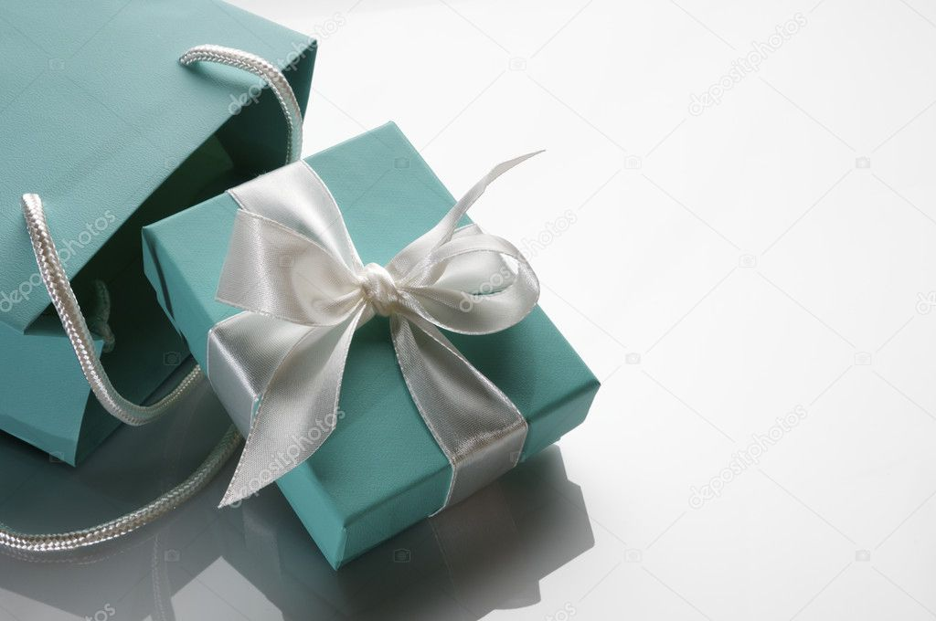 Small turquoise box tied with a white ribbon and bag — Stock Photo #5347598