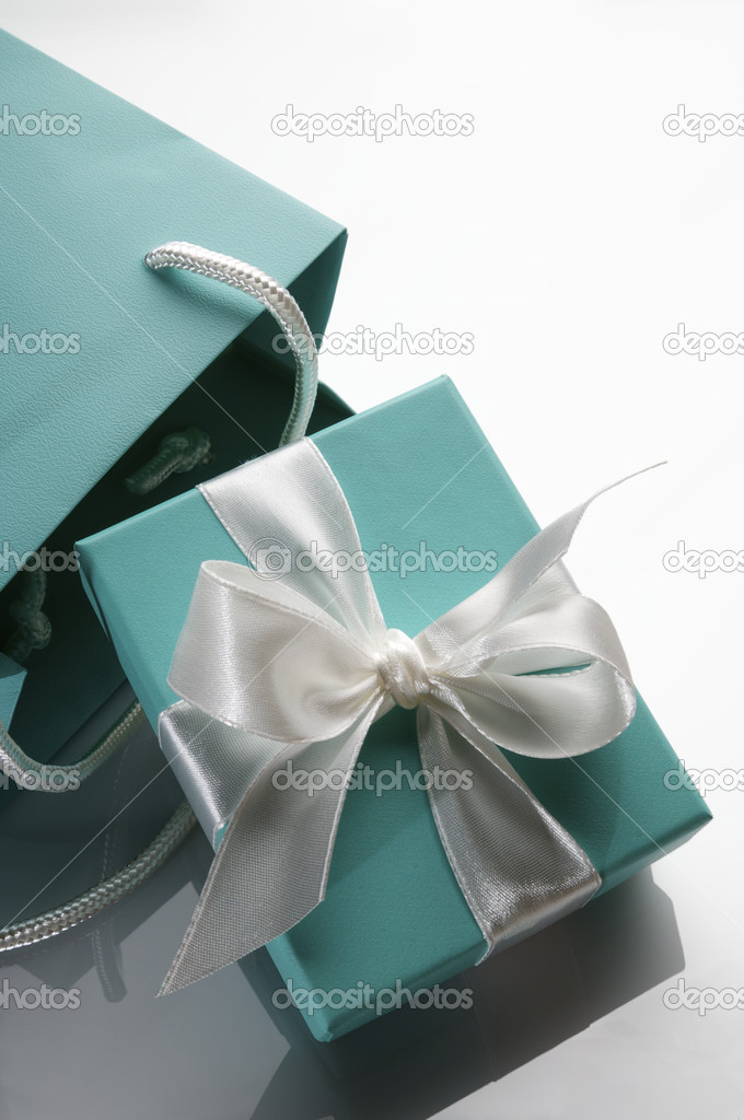 Small turquoise box tied with a white ribbon and bag — Stock Photo #5347602