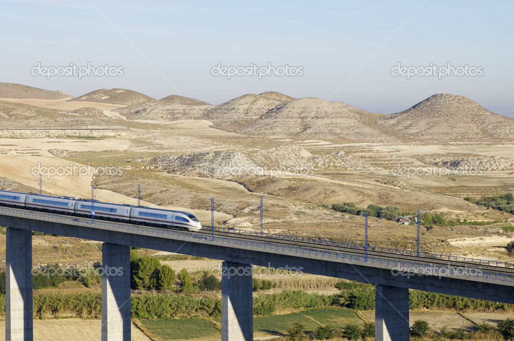 View of a high-speed train crossing a viaduct in Roden, Saragossa, Aragon, Spain; AVE Madrid Barcelona — Stock Photo #5349986
