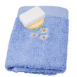 Soap and sponge on a towel — Stock Photo